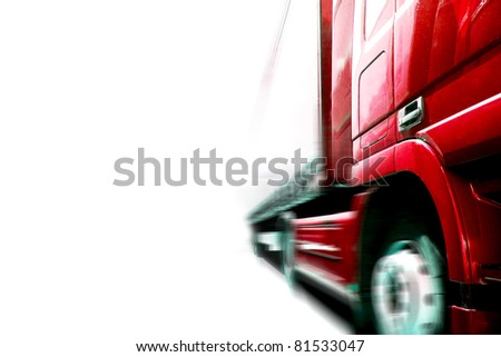 a fast traveling truck on the road - stock photo