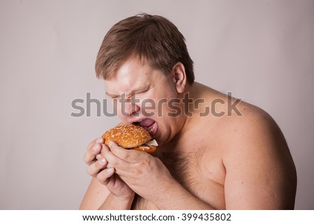 a fat man with a burger in his hand