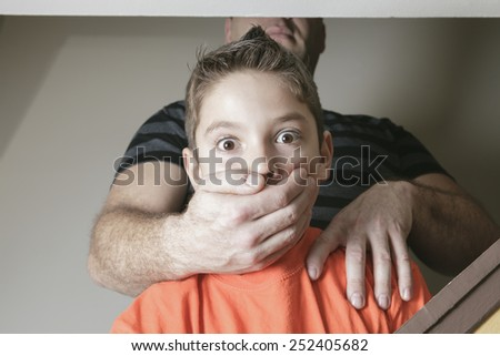 A father abused his young boy at home - stock photo