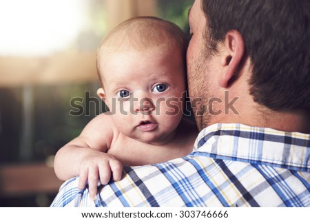 A Father and baby at home together, bedtime - stock photo