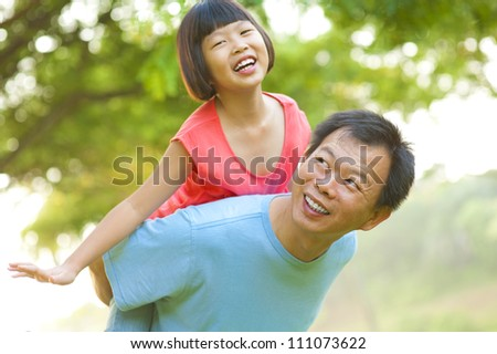 A father and child on a nice summer day. - stock photo