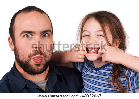 a father and daughter with silly faces - stock photo