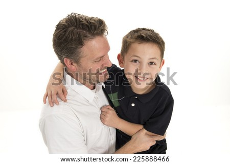 a father and son / engage themselves in horseplay / whilst on white background - stock photo