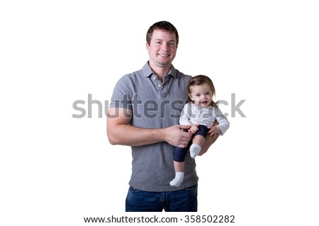 A father holding his daughter