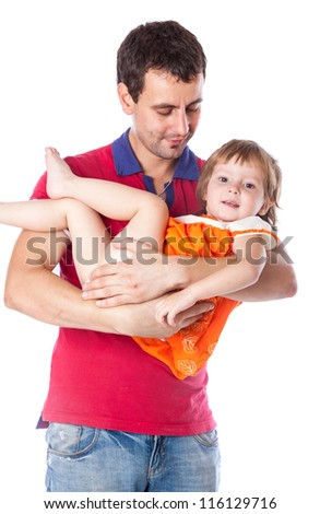 A father is holding his daughter. Isolated on a white background