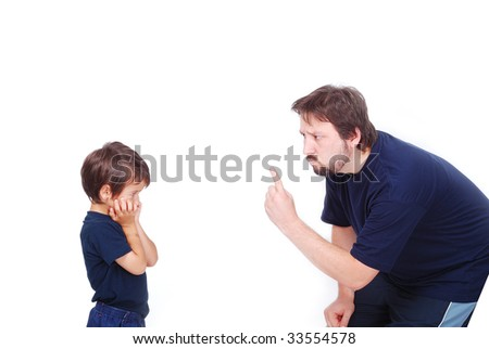 A father is threatening his little boy with a finger - stock photo