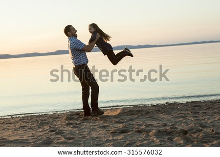 A Father with is daughter at the sunset
