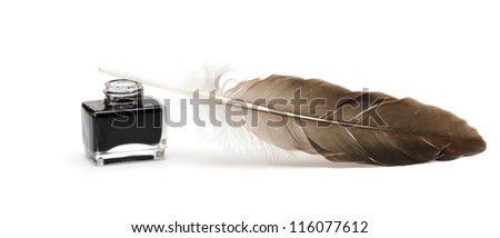 A feather pen, ink. Isolated on a white background. - stock photo