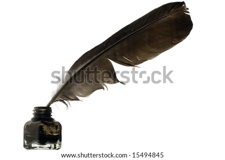 a feather quill in an ink bottle on white - stock photo