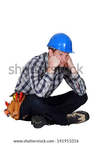 A fed-up and bored tradesman - stock photo