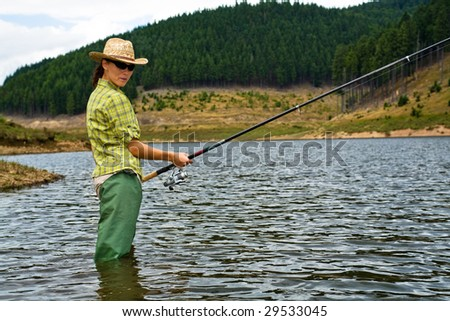 a female angler fishing in the river