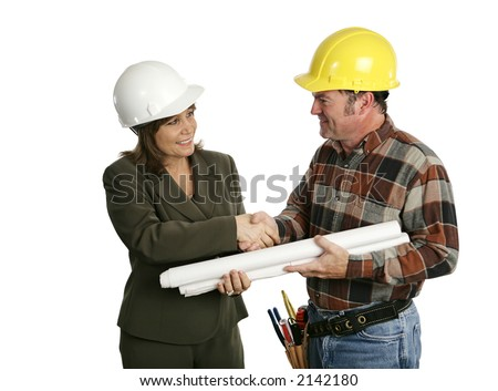 A female architect or engineer meeting with a building contractor.  Isolated on white. (focus on woman's face) - stock photo