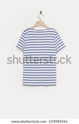 A female blue stripe t-shirts back side with wooden hanger isolated white background. - stock photo