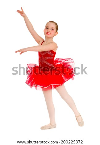 A Female Child Ballet Dancer In Red Tutu Recital Costume - stock photo