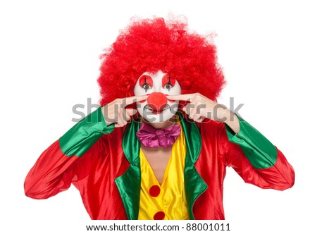 a female clown with colorful clothes and makeup - stock photo
