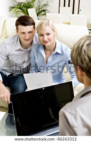 a female consultant at visiting young family