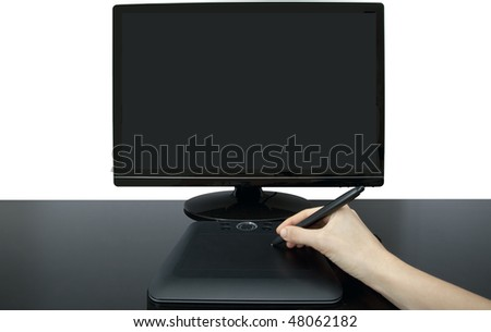 A female designer uses the pen and tablet to create an illustration on a monitor - stock photo