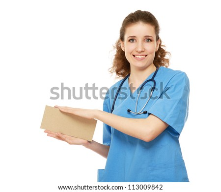 A female doctor holding a blank, isolated on white background - stock photo