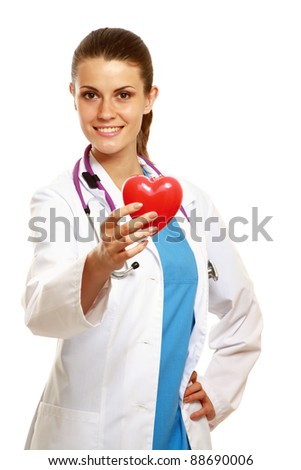 A female doctor holding a heart, isolated on white background - stock photo