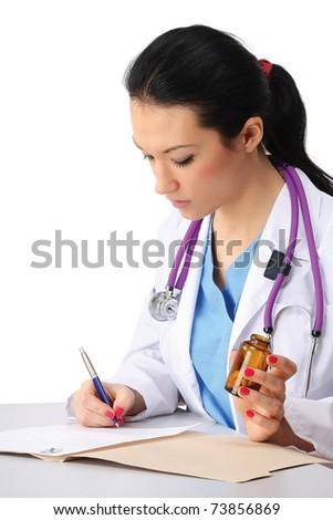 A female doctor making a a prescription - stock photo