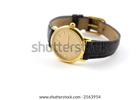 A female golden wrist watch with leather wristlet. - stock photo