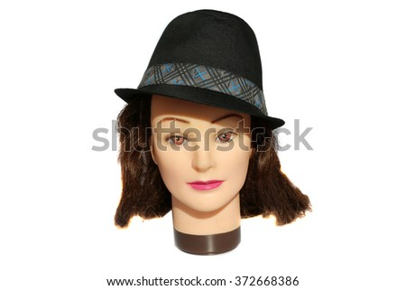 A female Hair Dressers Mannequin Head wears a Black Fedora Hat.  Isolated on white with room for your text. - stock photo