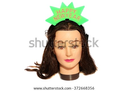A female Hair Dressers Mannequin Head wears a Happy New Year Light Up Head Band.  Isolated on white with room for your text. - stock photo