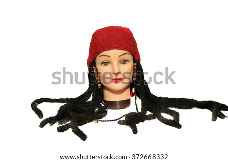 A female Hair Dressers Mannequin Head wears a Pirate Bandana with Dreadlocks Wig.  Isolated on white with room for your text. - stock photo