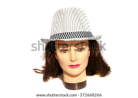 A female Hair Dressers Mannequin Head wears a White Fedora hat.  Isolated on white with room for your text. - stock photo
