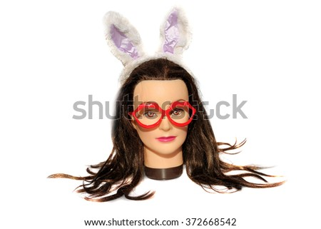 A female Hair Dressers Mannequin Head wears Red Lip Glasses and Bunny Ears.  Isolated on white with room for your text. - stock photo