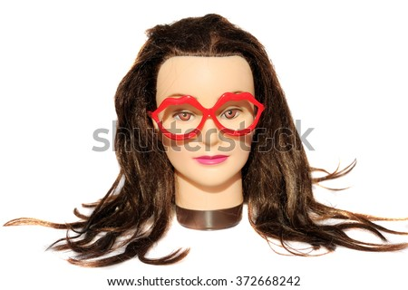 A female Hair Dressers Mannequin Head wears Red Lip Glasses.  Isolated on white with room for your text. - stock photo