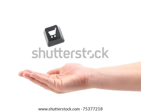 A female hand catching a keyboard shopping key