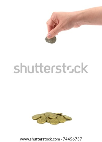 A female hand dropping coin isolated against a white background - stock photo