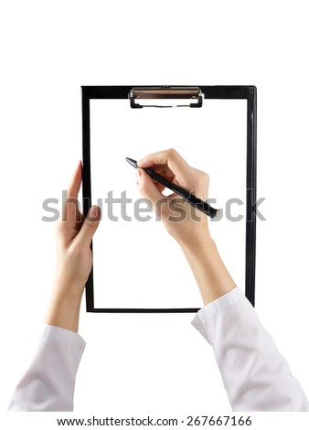 A female hand holding a pen and clipboard with blank paper (document, report) isolated on white background. Top view - stock photo