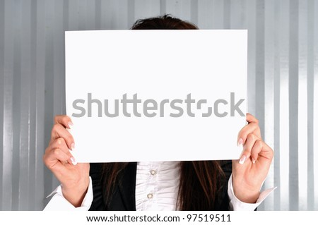 A female holding a blank sign - stock photo