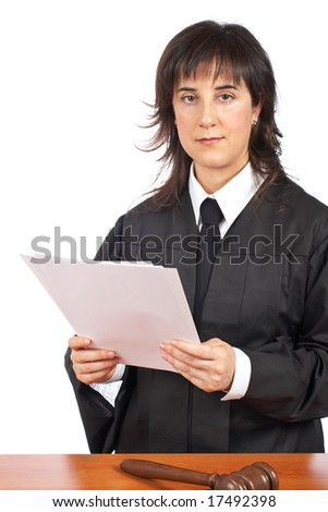 A female judge in a courtroom reading the verdict and striking the gavel. Shallow depth of field - stock photo