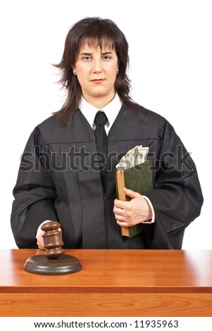 A female judge in a courtroom striking the gavel, accepting a bribe. Shallow depth of field - stock photo