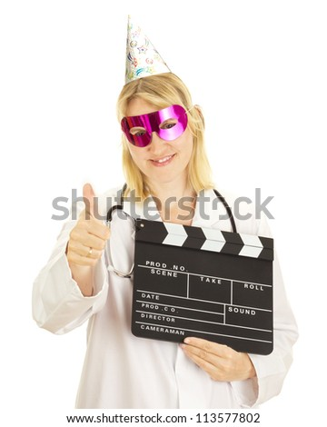 A female medical doctor with a clapperboard - stock photo