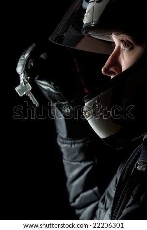 A female motorcyclist handing over a key