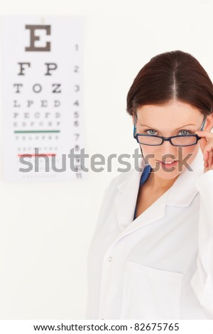 A female optician with glasses in an office