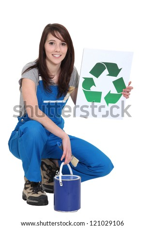 A female painter promoting recycling.