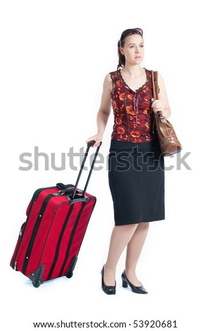 A female passenger pulling a suitcase on a white background - stock photo