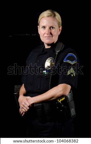 a female police officer in the night during her shift. - stock photo
