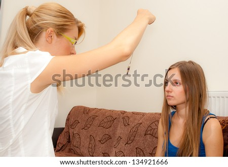 A female psychotherapist treats a teenage female patient with normal and cliche ways.