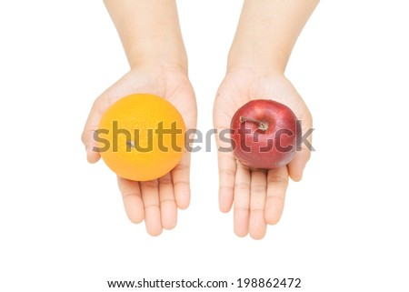 a female's hands gesture offering orange or apple. - stock photo