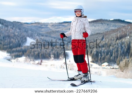 A female skier on the piste in mountain - stock photo