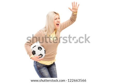 A female sport fan holding a football and shouting isolated on white background - stock photo