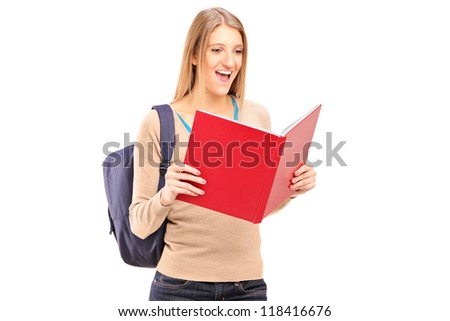 A female student reading a book isolated against white background - stock photo