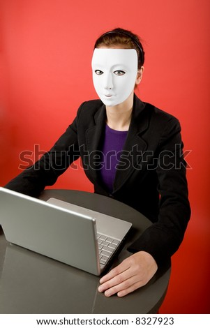 A female surfing the web anonymously - stock photo