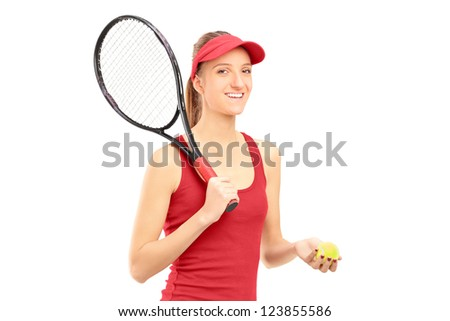 A female tennis player holding a racket and ball isolated against white background